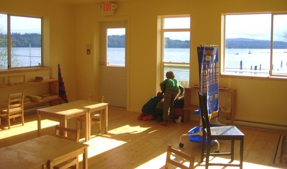 a fishing boat go by on the first day of classes in the new schoolhouse.